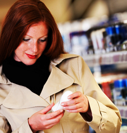 Woman Buying Lanolin Skin Care Products in a Drug Store
