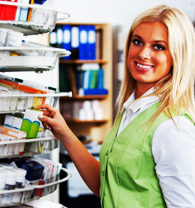 Woman Stock Keeper Refreshing Shelves With Skin Care Products (and Lanolin) in a Drug Store
