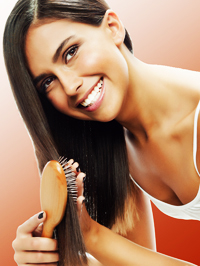 Woman Combing Beautifully Conditioned Dark Hair