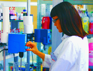 Woman Working in a Skin Care Development Laboratory on a Lanolin Based Product