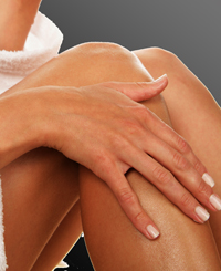 Woman Rubbing a Lanolin Based Lanicare (TM) Skin Product on Her Legs