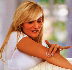 Woman Applying Lanicare™ Intensive Blend™ Lanolin Skin Formulation to Spot on Her Arm