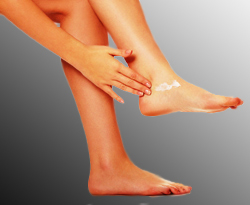 Woman Applying Lanicare™ Intensive Blend™ Lanolin Skin Forulation to Spot of Dry Skin on Her Leg